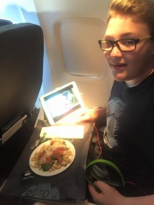 Kanen having dinner in first class on the way home.
